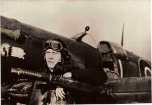 "Flt Lt John Harder relaxing against the wing of his Spitfire ""L for Lechery"""